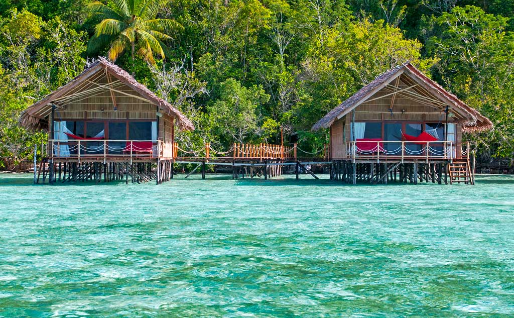 two of our Raja Ampat Overwater Bungalows shown from the ocean side