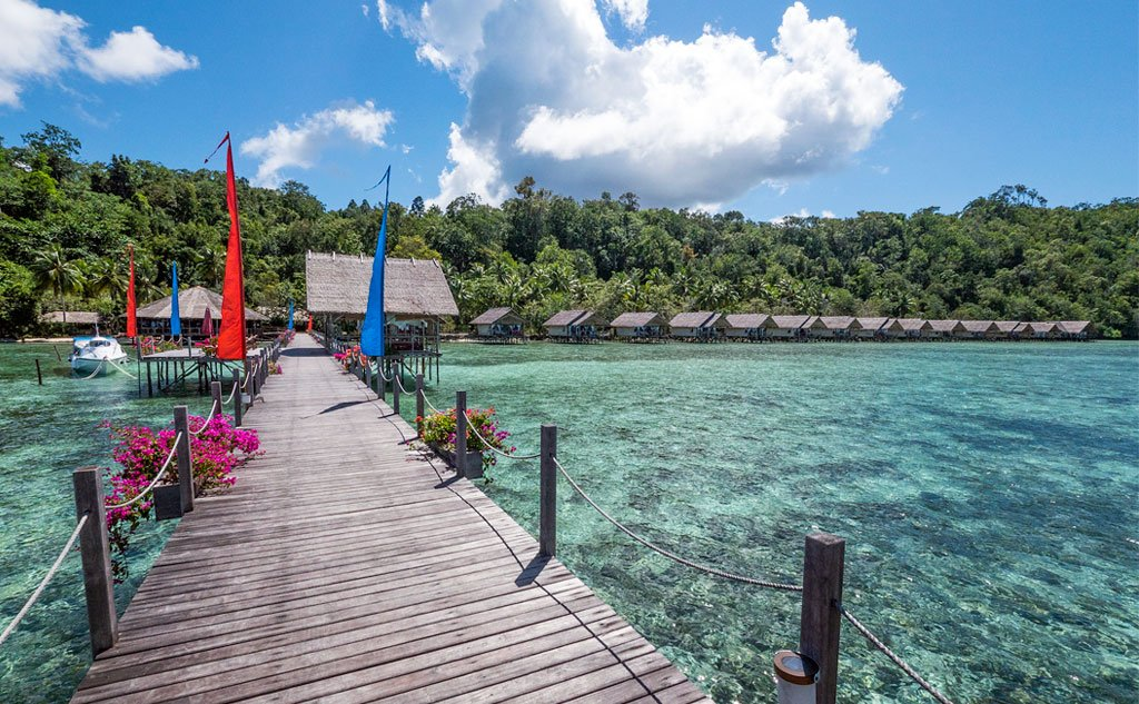 showing the main jetty and the water bungalows of Papua Explorers Eco Resort in Raja Ampat