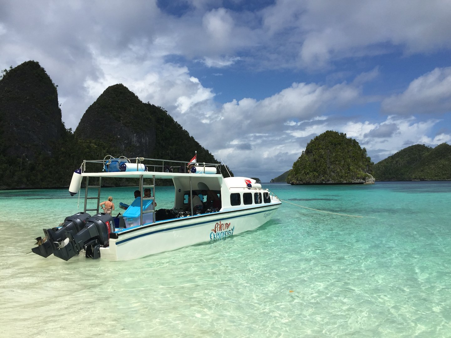 our Papua Explorers boat at a secluded beach in the wayag islands in raja ampat