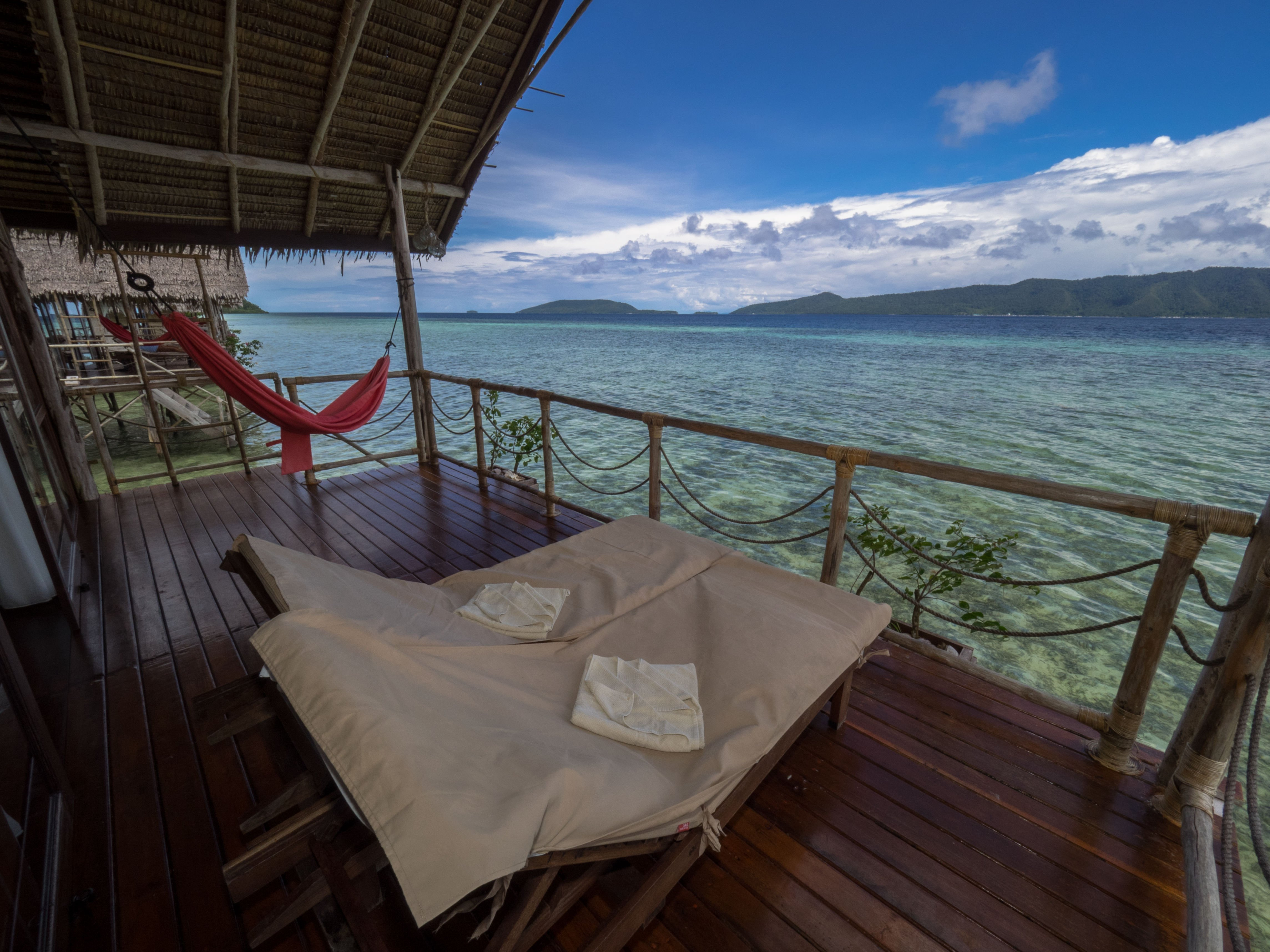 veranda with ocean view that each of our raja ampat overwater bungalows has