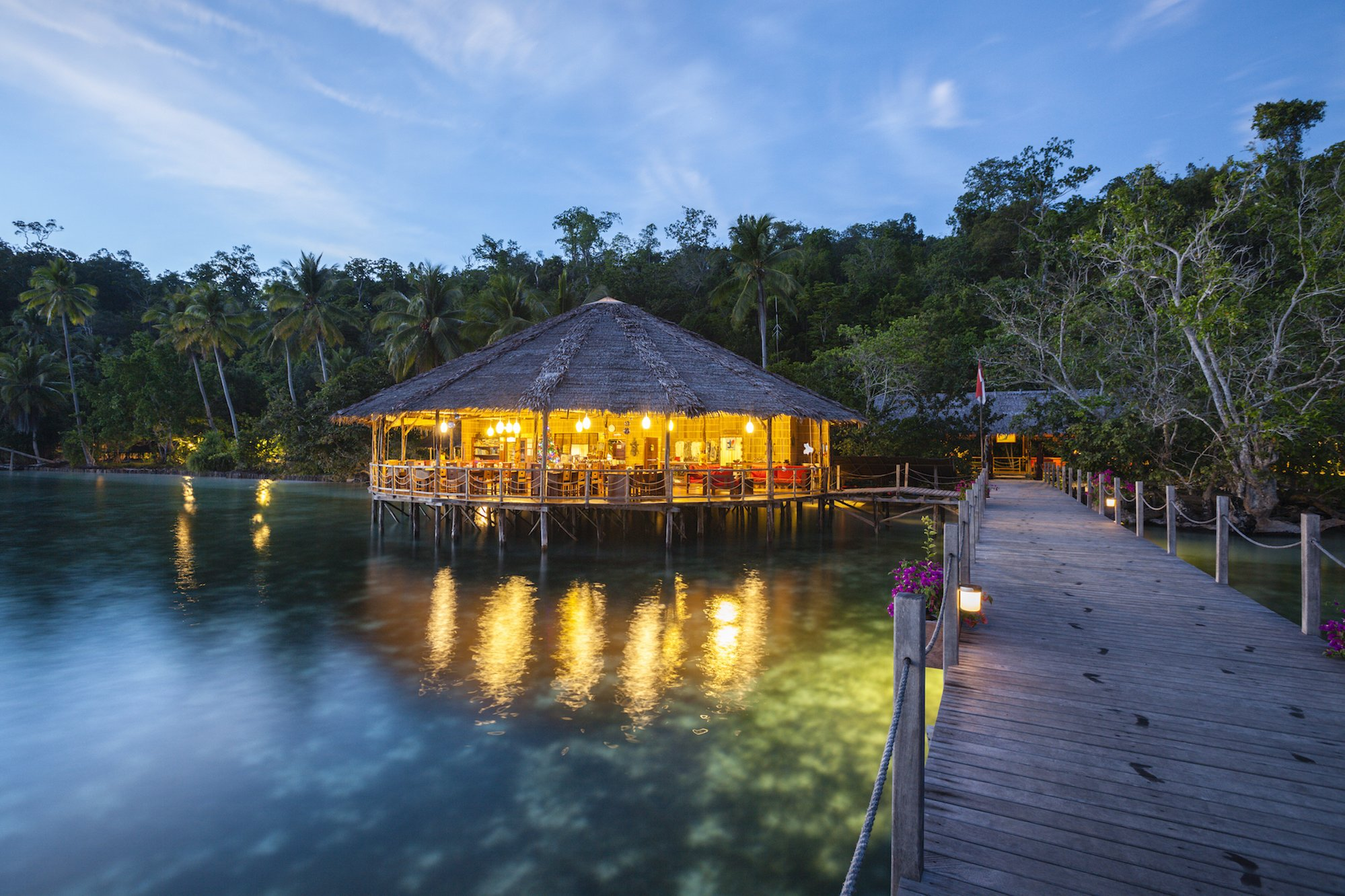 our cozy restaurant built on the waters of Raja Ampat with lush rainforest in the back