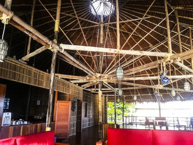 (English) the restaurant of our resort in Raja Ampat covered by a sophisticated wooden roof structure