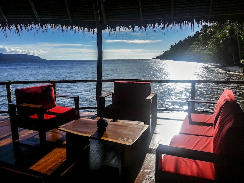 (English) comfortable seating area in our restaurant built over water in Raja Ampat