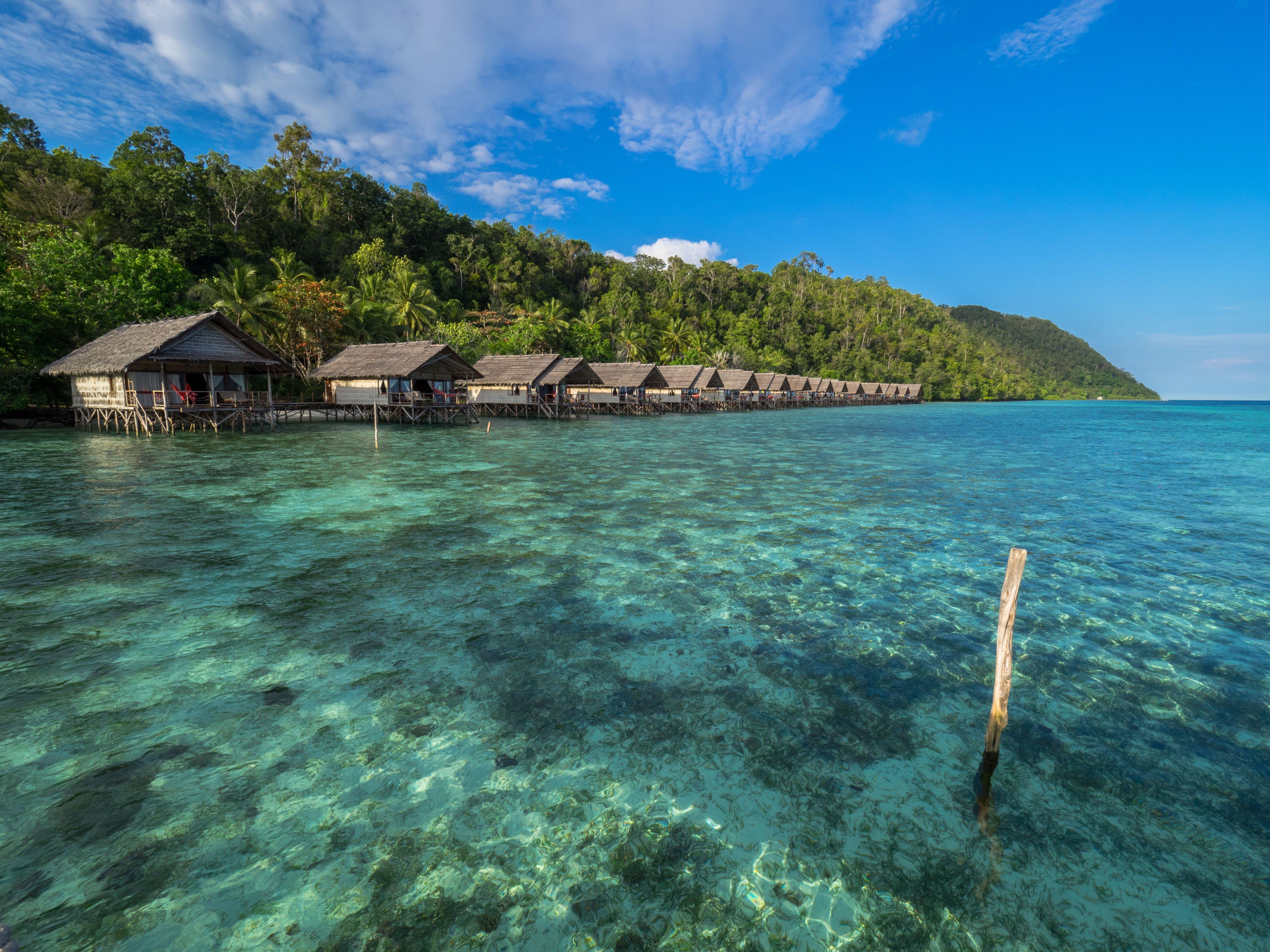 Water bungalows at the heart of raja ampat papua - Raja ampat explorers dive resort ...