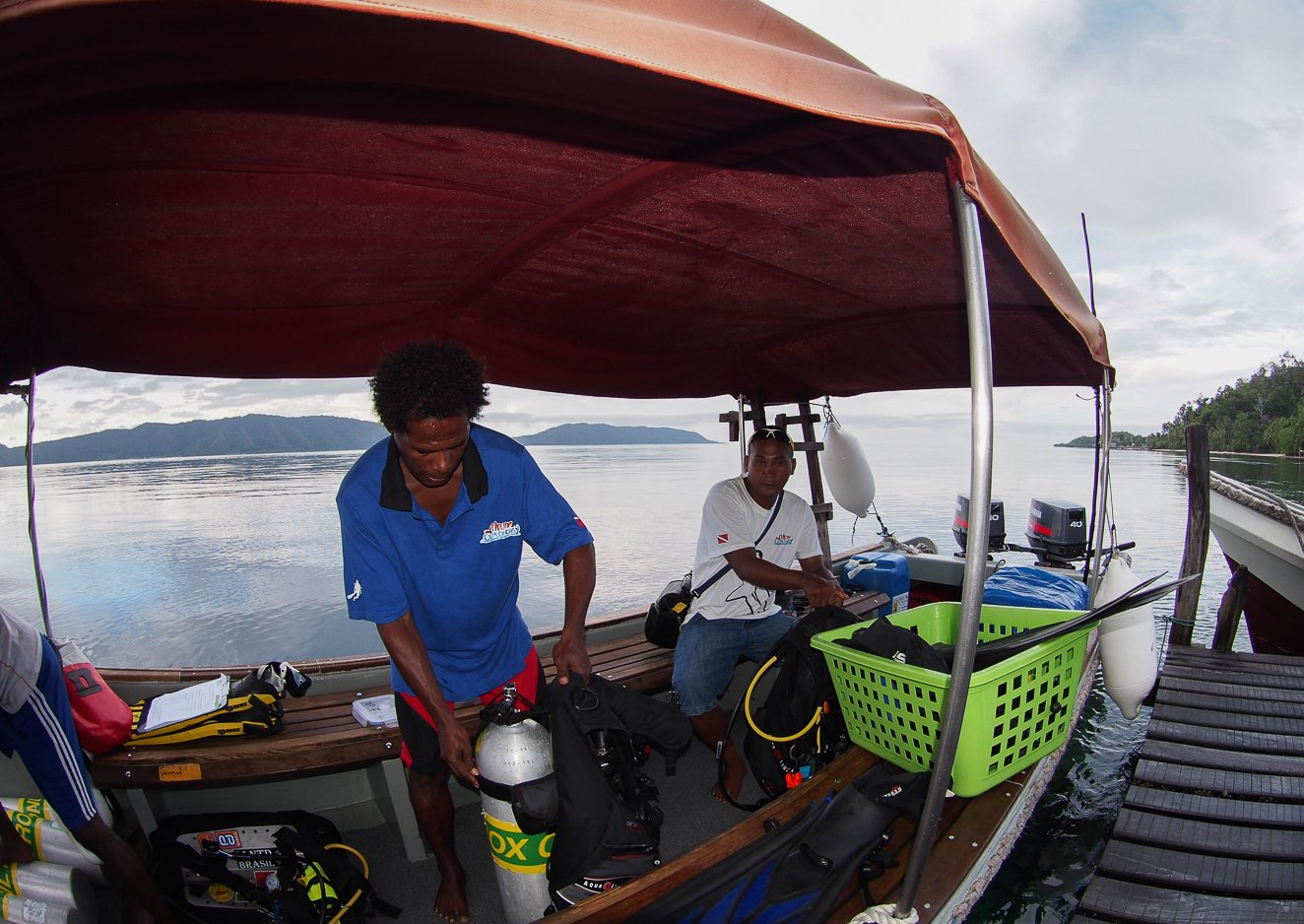 boat crew preparing scuba diving gear inside the boat