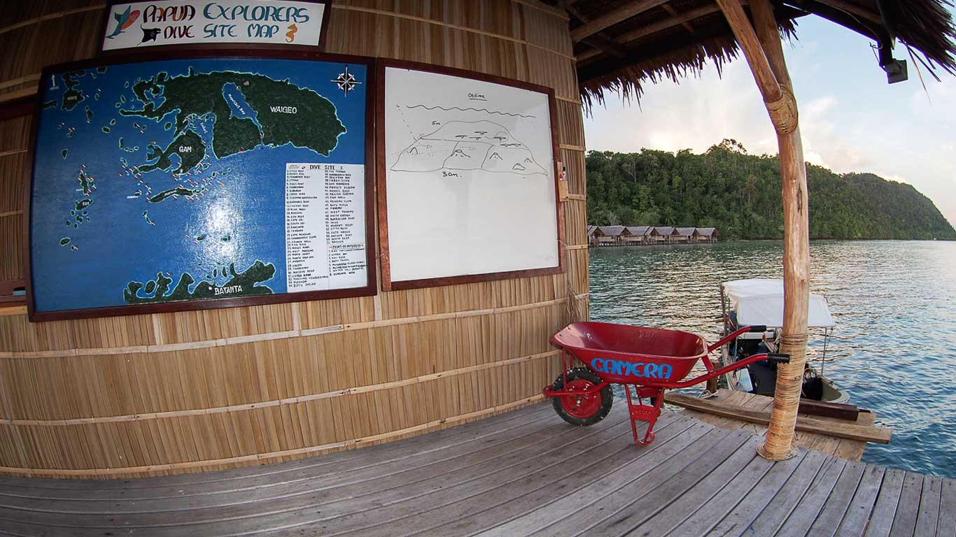 briefing board and map of the dive sites at our dive centre and a wheelbarrow for underwater cameras