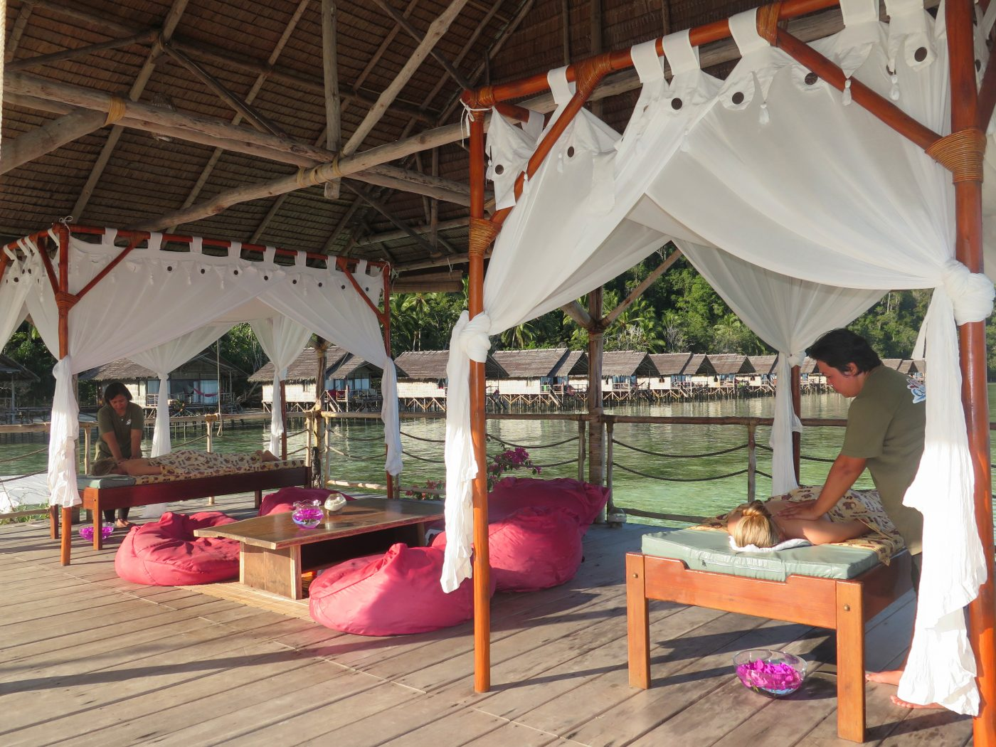 Our masseuses giving two ladies a massage at our Papua Explorers spa in Raja Ampat