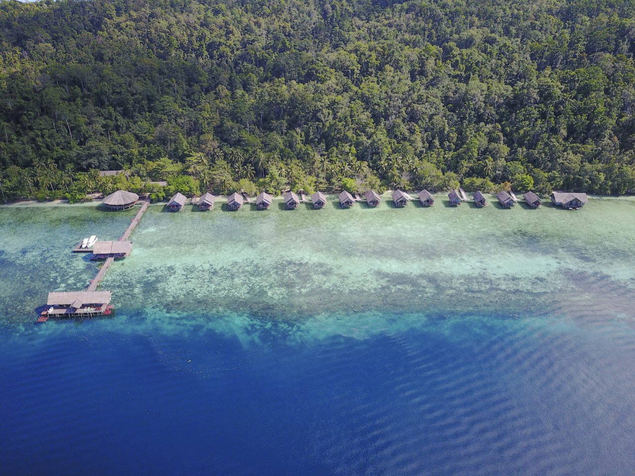 An aerial drone shot of our resort in raja Ampat