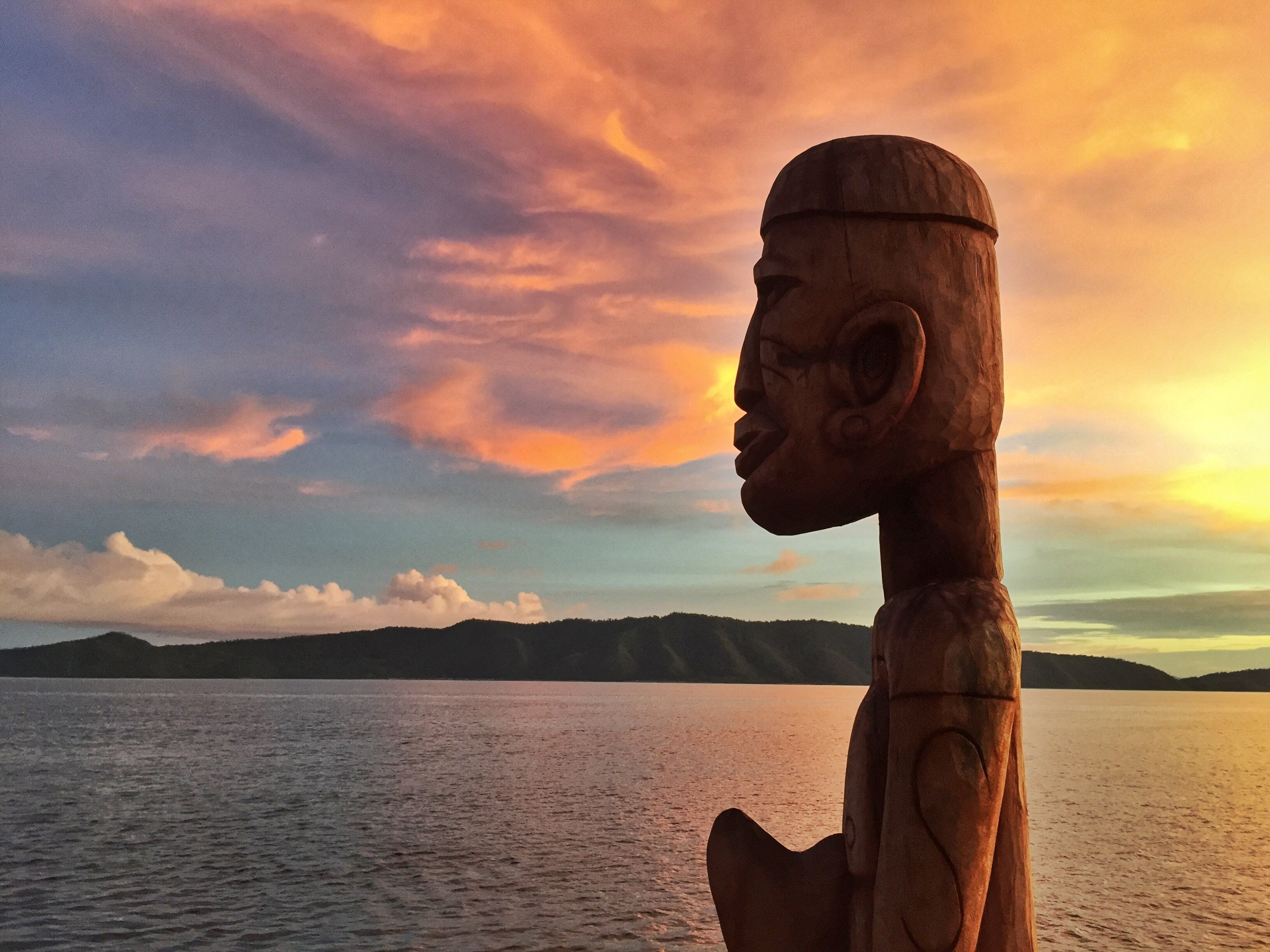 (English) large handmade wooden statue on the jetty of our dive center in Raja Ampat