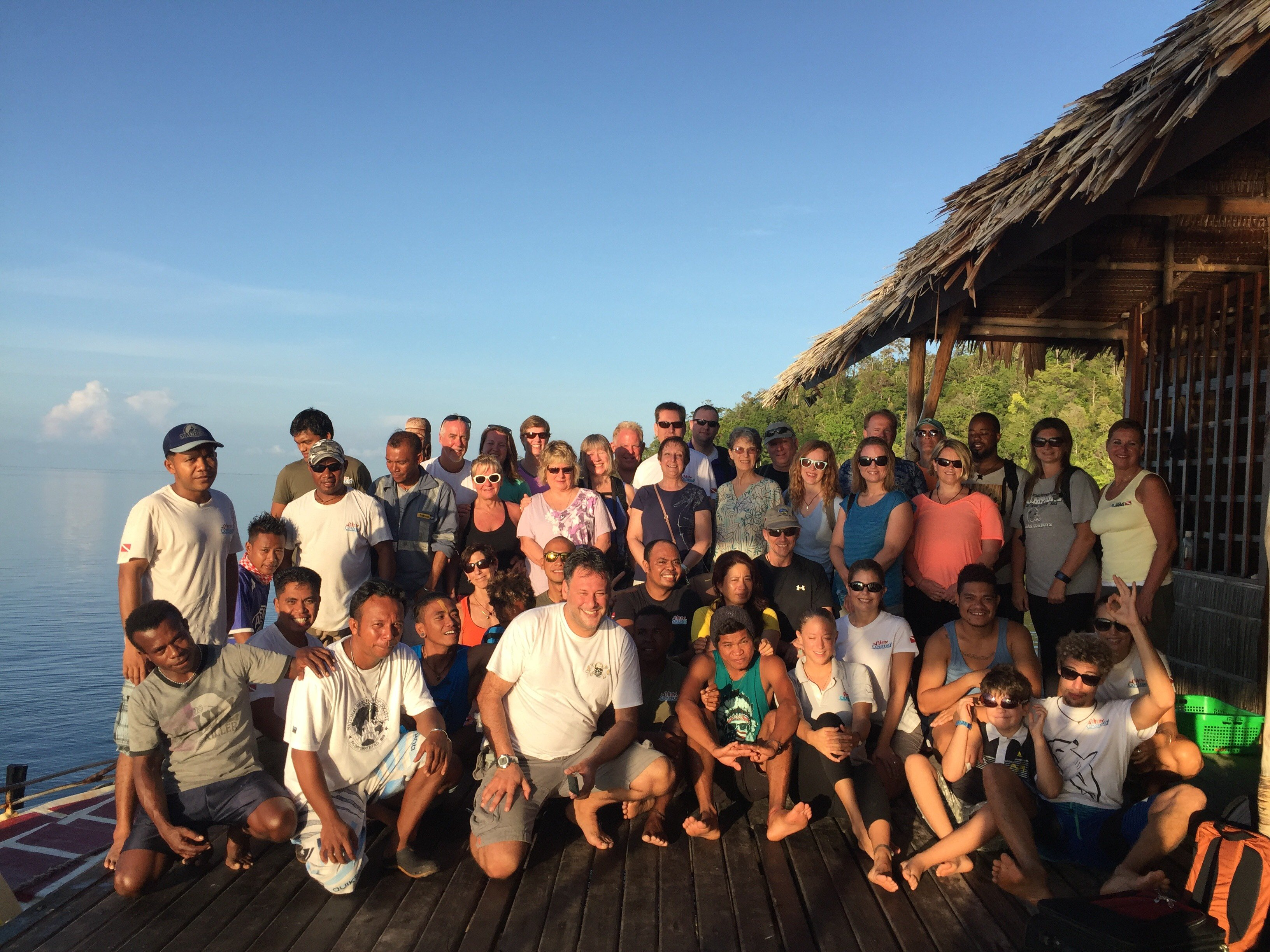 group photo of guests and employees of our dive resort in Raja Ampat