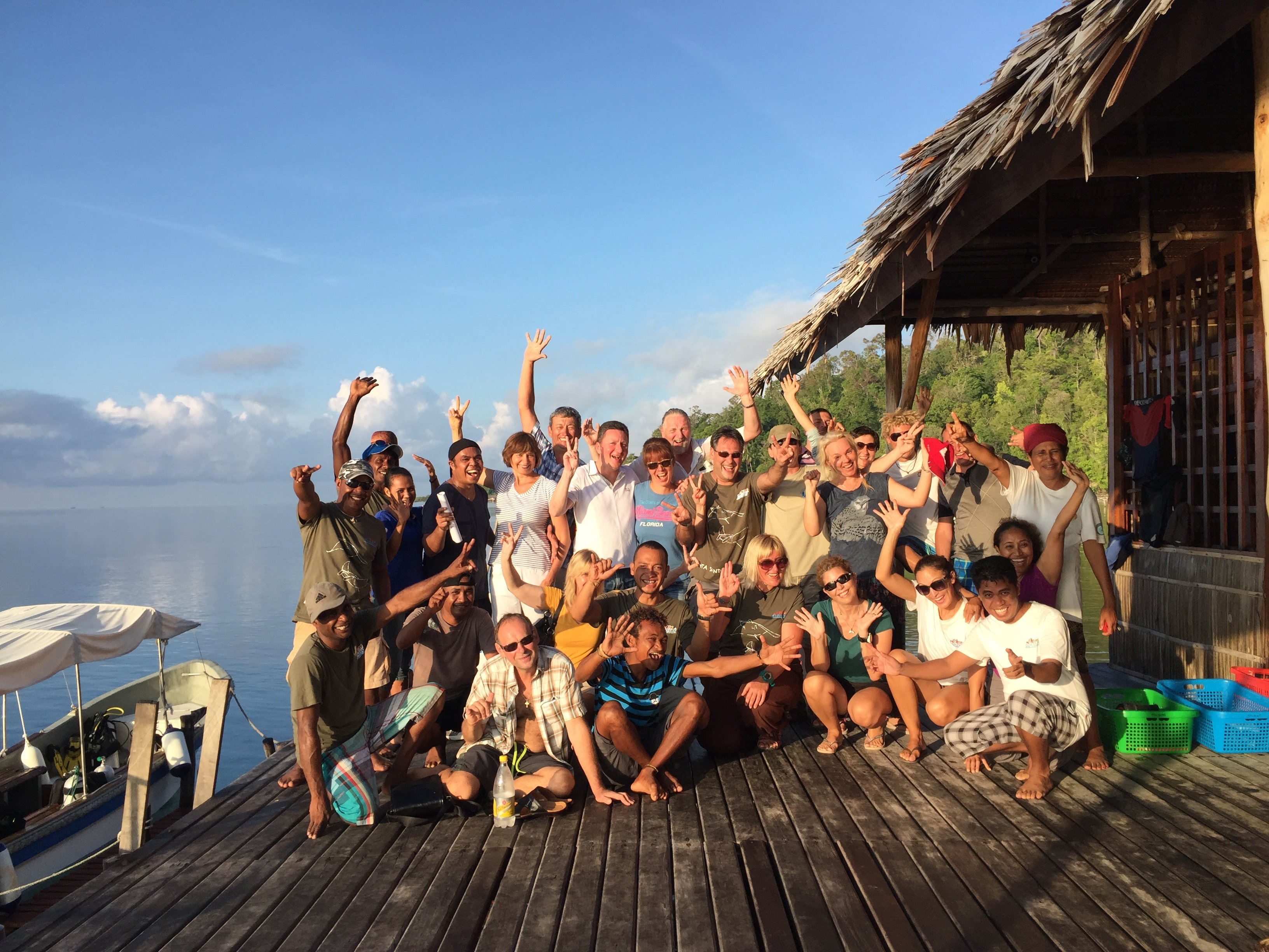 group picture of guests and staff of our dive resort in Raja Ampat before departure by boat back to Sorong