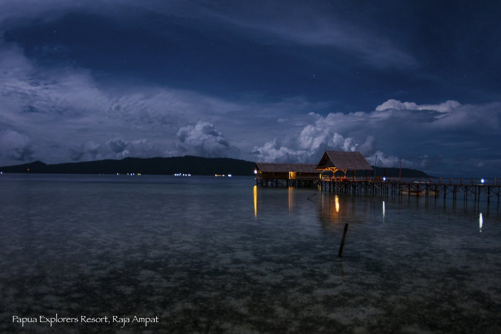 evening sky brightened by the moon with our Raja Ampat dive centre and spa below