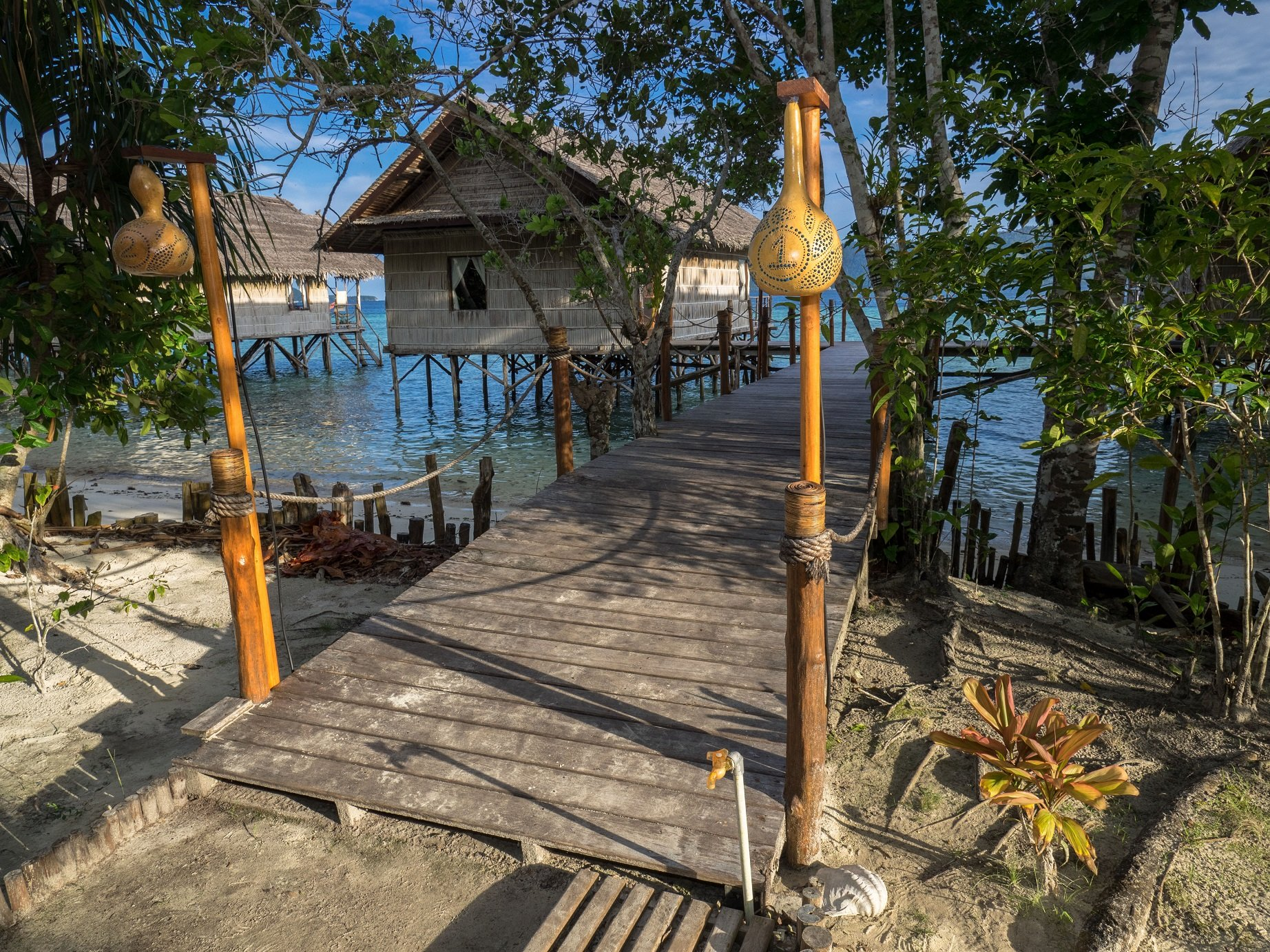 view from the path behind our Raja Ampat Dive Resort towards our water cottages and jetties