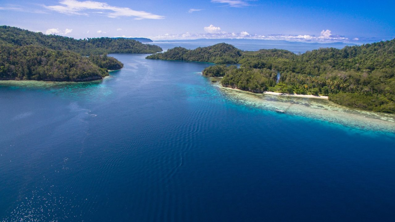 (English) a group of islands close to Papua Explorers Dive Resort from above