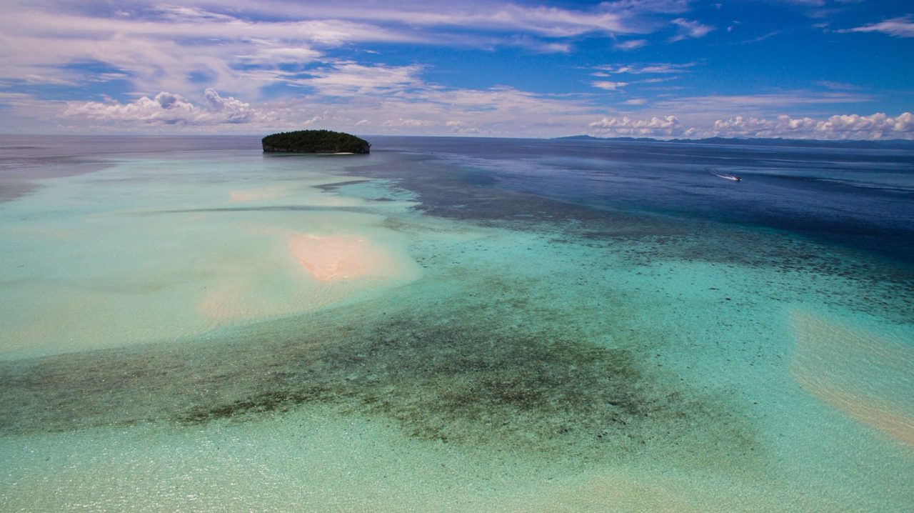 panoramic view of a sandbank and island used for diving breaks near Papua Explorers Resort