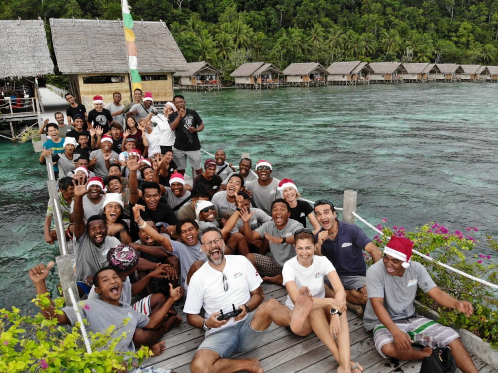 group photo of our employees and managers at our dive resort in Raja Ampat