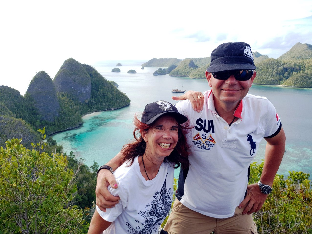 Papua Explorers and Coralia Liveaboard Guests Gabby & Thierry in Raja Ampat at the Wayag viewpoint
