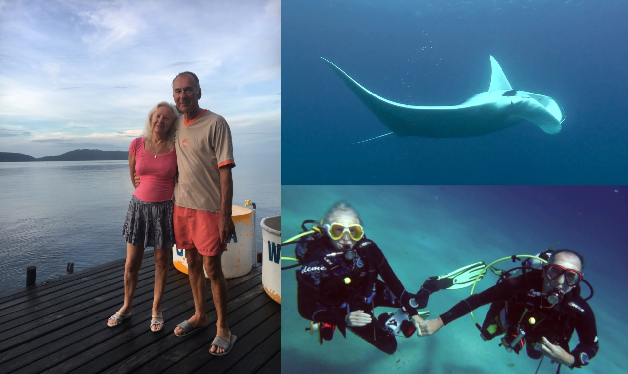 two of our guests at Papua Explorers dive centre, while diving and a manta ray