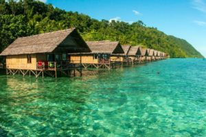 some of our water bungalows above blue-green ocean