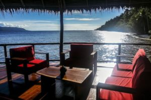 comfortable seating area in our restaurant built over water in Raja Ampat