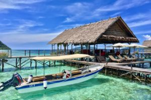 Diving Boat, sundeck and spa in the background at Papua Explorers in Raja Ampat