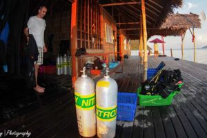 a guest preparing to go diving at our dive centre in Raja Ampat