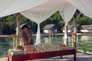 a lady getting a massage treatment at our Papua Explorers spa in Raja Ampat above the water