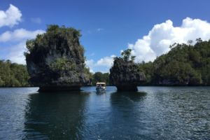 our Papua Explorers boat between mushroom islands on the way back from the Passage in Raja Ampat
