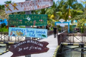 signs on the jetty of Arborek not far from Papua Explorers Dive Resort reminding to treat the environment with care